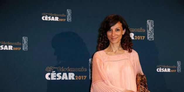 Director Houda Benyamina poses with her trophy during a photocall after receiving the Best First Film...