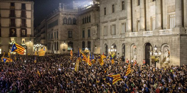 Pro-independence supporters gather at Sant Jaume square to celebrate following the parliamentary vote...