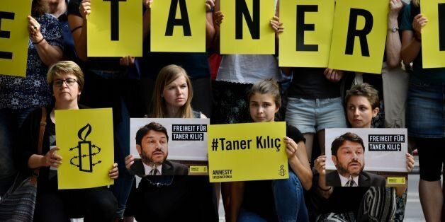 Activists of Amnesty International stage a protest against the detention of the head of Amnesty International...
