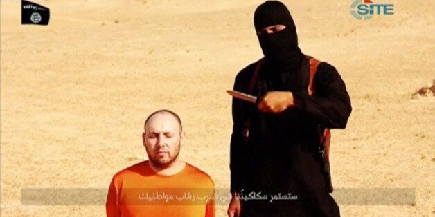 A masked, black-clad militant, who has been identified by the Washington Post newspaper as a Briton named...