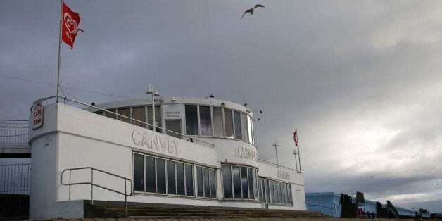 A seagull flies above the Labworth Cafe, designed by the engineer Ove Arup and built in the 1930s to...