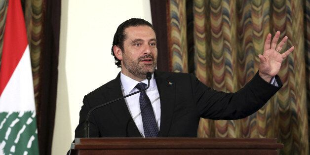 Lebanon's Prime Minister Saad al-Hariri gestures as he talks at the governmental palace in Beirut, Lebanon...