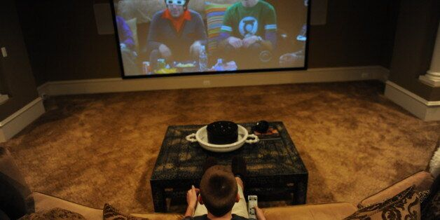 LEESBURG, VA - MARCH 25: Cole Pendergrast watches TV in the family's basement theater room at the family...
