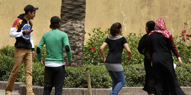 Youth try to harass women on a street in Cairo April 8, 2013. Egypt's National Council for Women (NCW)...