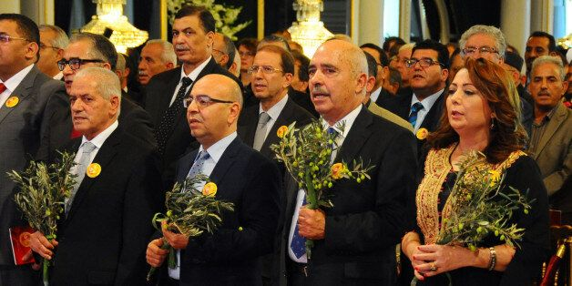 Wided Bouchamaoui president of the Tunisian employers, right, Abdessattar Ben Moussa, president of the...