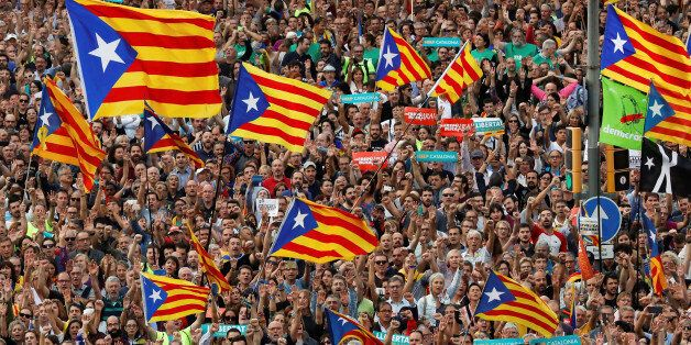 People wave Catalan separatist flags during a demonstration organised by Catalan pro-independence movements...