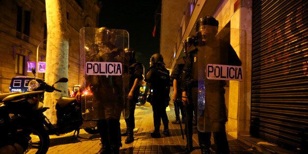 Officers of the Spanish National Police stand outside the High Court of Justice of Catalonia in Barcelona,...