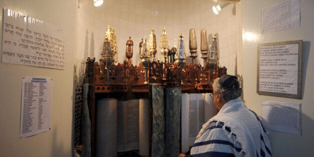 A Tunisian Jew prays at the Synagogue in La Goulette on the outskirts of Tunis on February 1, 2011 in...