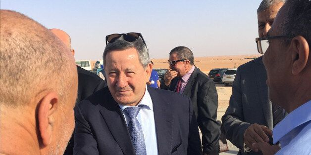 Sonatrach's CEO Abdelmoumen Ould Kaddour (C) talks to employees during his visit at a gas site in Hassi...