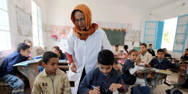 A Tunisian teacher supervises a class of Muslim and Jewish students at the national school in Djerba...
