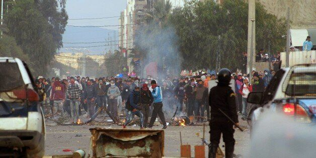 Tunisian protesters clash with security forces in the central town of Kasserine on January 21, 2016.Fresh...
