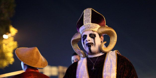 Revellers celebrate in costume at the West Hollywood Halloween Carnaval in West Hollywood, California,...