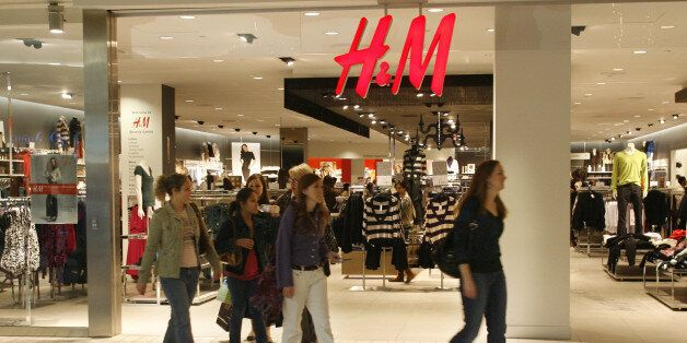 Holiday shoppers walk past fashion store H&M at The Beverly Center shopping mall in Los Angeles, California,...