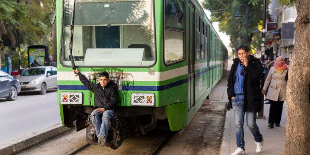 Tunis, Tunisian Republic, January 3, 2015. -- A stowaway on a the so called 'Metro' (Tram) of Tunis....