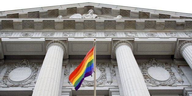 Lesbian, gay, bisexual, and transgender pride flag flying outside a government