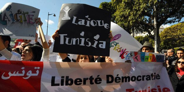 Demonstrators protest on Habib Bourguiba Avenue in Tunis on February 19, 2011, to demand a secular state...