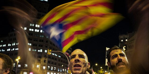 BARCELONA, SPAIN - OCTOBER 21: Waving Catalan flags and shouting here at national Spanish network TVE...