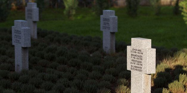 Crosses of killed german WWII soldiers are seen at the newly opened cemetary for German WWII soldiers,...