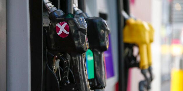 BUENOS AIRES, ARGENTINA - JANUARY 06: Close-up of pump nozzles for different fuels on an AXION gas station...