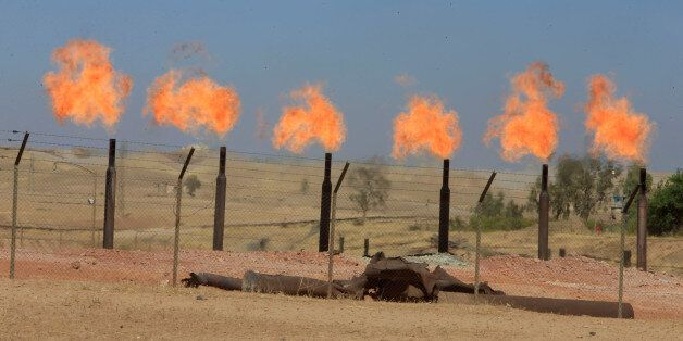 Flames emerge from flare stacks at the oil fields in Dibis area on the outskirts of Kirkuk, Iraq October...