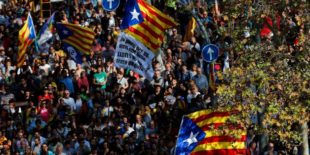 People holding Esteladas (Pro-independence Catalan flag) gather outside the Catalan parliament in Barcelona...