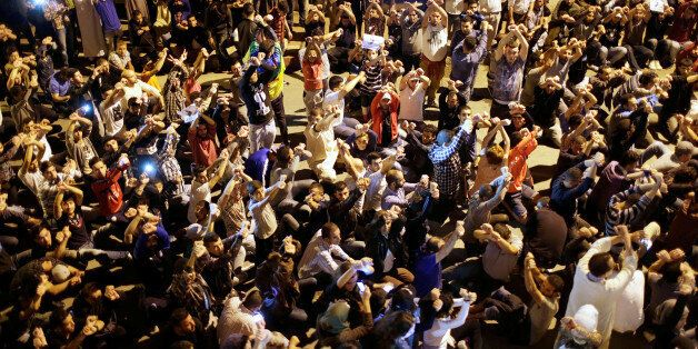 Moroccans shout slogans during a demonstration in the northern town of Al-Hoceima against official abuses...