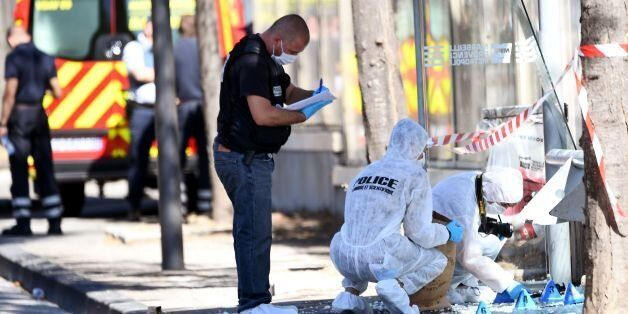 French forensic police search the site following a car crash on August 21, 2017, in the southern Mediterranean...
