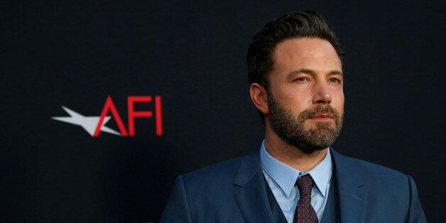 Cast member Ben Affleck poses at the premiere