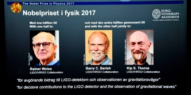 Laureates (L-R) Rainer Weiss, Barry C Barish and Kip S Thorne are pictured on a display during the announcement...