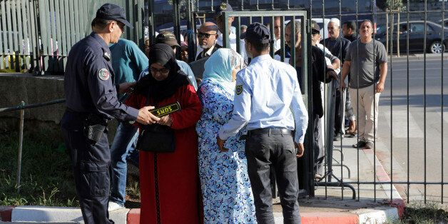 Moroccan police inspect relatives of the leaders of Morocco's Hirak protest movement as they arrive to...