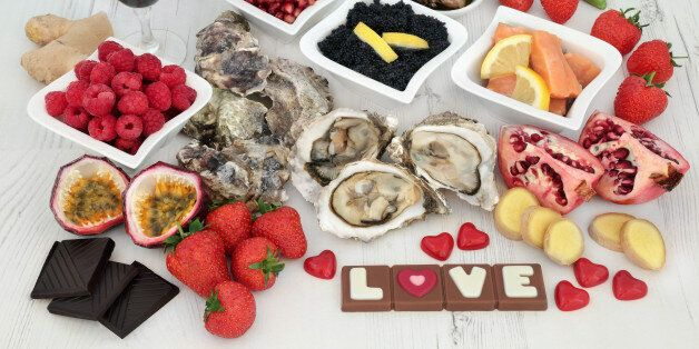 Valentines day aphrodisiac food and drink selection for good sexual health forming a background over...