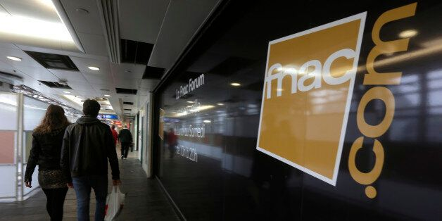 People walk past a books, electronics and CD retailer Fnac store in Paris, October 8, 2012. PPR group...
