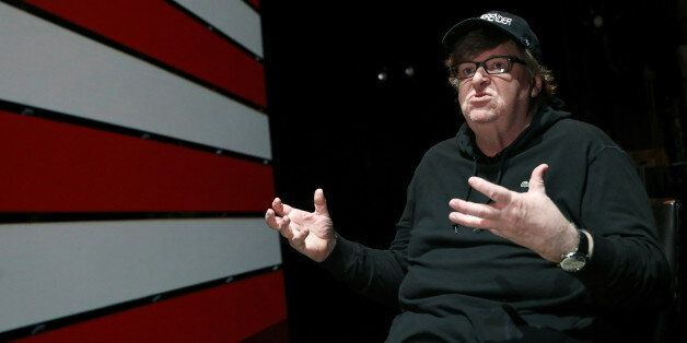 Michael Moore speaks during an interview at the site of his one-man Broadway show at the Belasco Theatre...