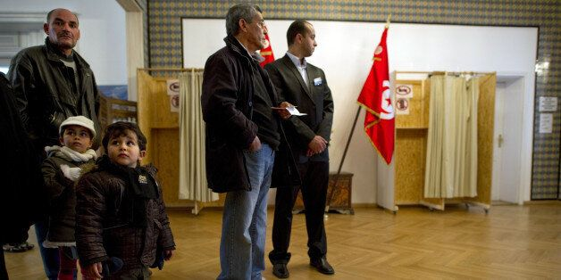 Tunisian expats queue up to vote at the Tunisian embassy in Berlin on October 21, 2011. Around 80,000...