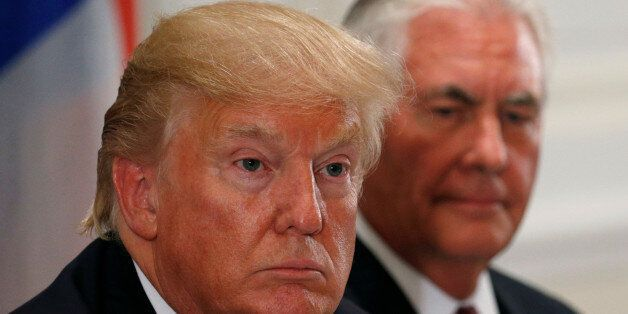 U.S. President Donald Trump and U.S. Secretary of State Rex Tillerson (R) attend a working dinner with...