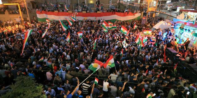 Kurds celebrate to show their support for the independence referendum in Duhok, Iraq, September 26, 2017....