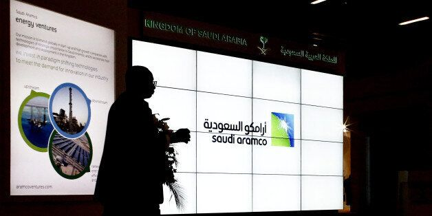 A Saudi Arabian Oil Co. (Aramco) logo sits on an electronic display at the company's corporate pavilion...