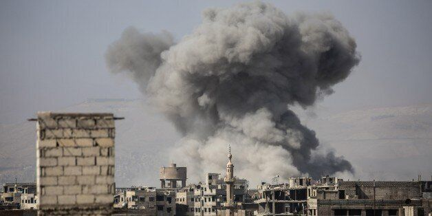 DAMASCUS, SYRIA - OCTOBER 6 : A huge explosion sends clouds into the air after Assad Regime's forces...