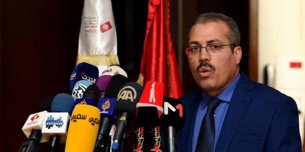 The Acting President of the Independent High Authority for Elections (ISIE), Anouar Ben Hassine, gives...