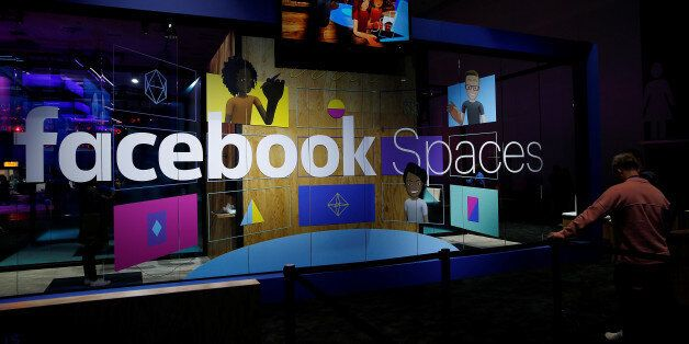 An attendee waits to try the newly announced Facebook Spaces virtual reality platform during the annual...