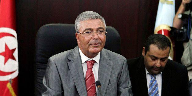 Tunisian Defence Minister Abdelkarim Zbidi speaks during a meeting with U.S. Defense Secretary Leon Panetta...
