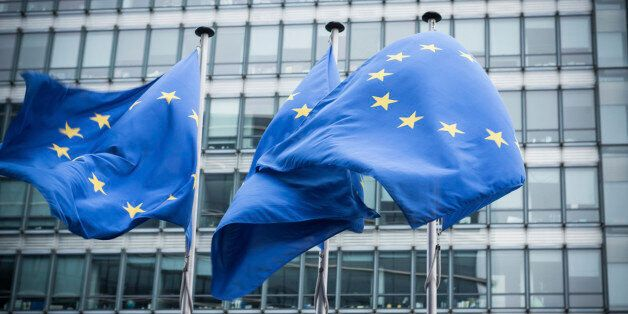 'European flags in front of the European Commission headquarters in Brussels, Belgium. ( Motion Blurred...