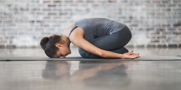 Young Woman Doing Yoga Meditation and Stretching Exercises. Stock