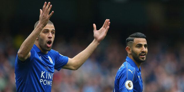 MANCHESTER, ENGLAND - MAY 13: Islam Slimani of Leicester City and Riyad Mahrez of Leicester City reacts...