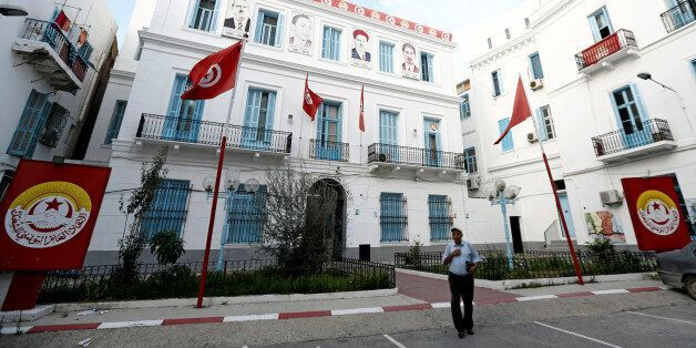 A man walks walk out of the headquarters of the General Union of Tunisian Workers (UGTT) in Tunis, Tunisia,...