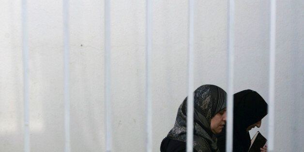 Suspects in the Ansar el Mehdi (Mehdi Partisans) trial arrive at the courthouse in Sale, near Rabat November...