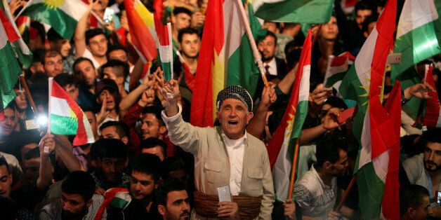 Kurdish people celebrate to show their support for the upcoming September 25th independence referendum...