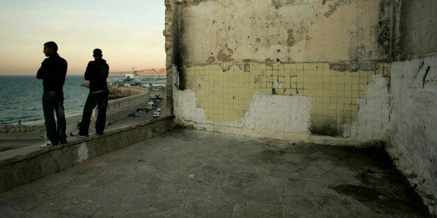 Homeless boys look out at the Strait of Gibraltar near the port in Tangier October 10, 2009. More than...
