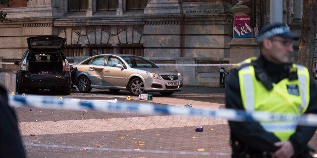 Police Officers and emergency workers are pictured on the site of a car crash outside the Natural History...