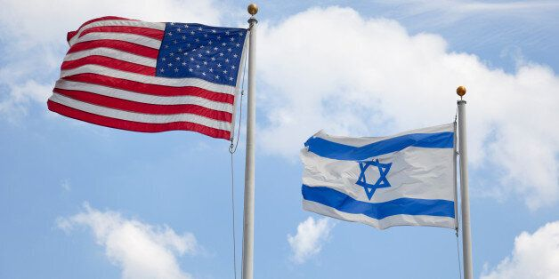 United States & Israeli flags wave together in unison symbolizing concepts such as the American/Israeli...